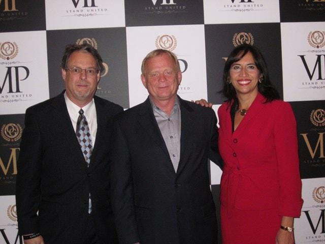Scott Warren, Organo Gold's Vice President, Norm Perrett, and Anabella Bonfa